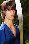 Portrait of Teenage Boy in Karate Uniform Holding Sword    Stock Photo - Premium Rights-Managed, Artist: SimplyMui, Code: 700-02738857