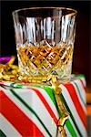Close up of a glass of whiskey on a gift box    Stock Photo - Premium Rights-Managed, Artist: ableimages, Code: 822-02738947