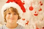 Close up of a boy wearing a red and white Christmas hat    Stock Photo - Premium Rights-Managed, Artist: ableimages, Code: 822-02739177
