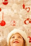 Close up of a girl in a furry Christmas hat looking up    Stock Photo - Premium Rights-Managed, Artist: ableimages, Code: 822-02739362
