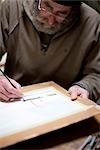 Close up of an artist painting at his desk    Stock Photo - Premium Rights-Managed, Artist: ableimages, Code: 822-02739406