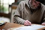 Close up of an artist painting at his desk    Stock Photo - Premium Rights-Managed, Artist: ableimages, Code: 822-02739407