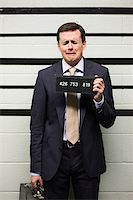 Mugshot of businessman Stock Photo - Premium Royalty-Freenull, Code: 614-02739970