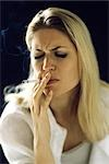 Woman smoking, eyes closed Stock Photo - Premium Royalty-Free, Artist: Norbert Schäfer, Code: 632-02744691