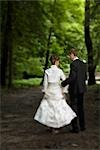Bride and Groom Walking in Woods, Chamonix, Haute-Savoie, France