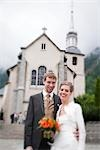 Bride and Groom Standing in Front of Church, Chamonix, Haute-Savoie, France