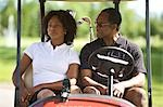 Couple Sitting in Golf Cart    Stock Photo - Premium Royalty-Free, Artist: Blue Images Online, Code: 600-02751462