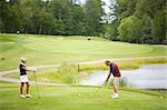 Couple Golfing    Stock Photo - Premium Royalty-Free, Artist: Blue Images Online, Code: 600-02751468