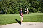 Sideview of Man in Sand Trap on Golf Course    Stock Photo - Premium Royalty-Free, Artist: Blue Images Online, Code: 600-02751482