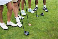 Close-up of Golfers' Feet Stock Photo - Premium Royalty-Freenull, Code: 600-02751522