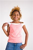 Portrait of African American teenage girl, studio shot    Stock Photo - Premium Rights-Managednull, Code: 842-02751648