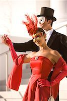 Couple in masquerade costumes standing outside theater    Stock Photo - Premium Rights-Managednull, Code: 842-02754354