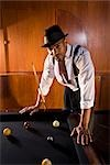 Portrait of African American man leaning over billiards table in 1920s bar    Stock Photo - Premium Rights-Managed, Artist: Kablonk! RM, Code: 842-02754567