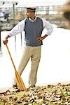 Portrait of African American gentleman with oar near water at garden party    Stock Photo - Premium Rights-Managed, Artist: Kablonk! RM, Code: 842-02754657