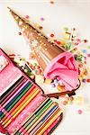 Open Pencil Case and Spilled Candy    Stock Photo - Premium Rights-Managed, Artist: Klick, Code: 700-02756417
