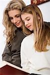 Mother and Daughter Reading    Stock Photo - Premium Royalty-Free, Artist: Siephoto, Code: 600-02756526
