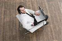 Businessman Using Laptop Stock Photo - Premium Royalty-Freenull, Code: 600-02756616