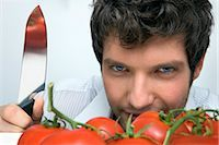 Man With Knife and Tomatoes    Stock Photo - Premium Rights-Managednull, Code: 700-02756603