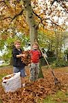 Kids Raking Leaves Stock Photo - Premium Royalty-Free, Artist: Chris Karges, Code: 600-02757056