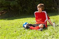 Teenage Boy Wearing Soccer Uniform and Sitting on Grass    Stock Photo - Premium Rights-Managednull, Code: 700-02757198