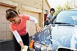 Mother and Teenage Son Washing Car    Stock Photo - Premium Rights-Managed, Artist: SimplyMui, Code: 700-02757202