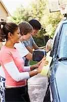 Mother and Teenage Sons Washing Car    Stock Photo - Premium Rights-Managednull, Code: 700-02757205