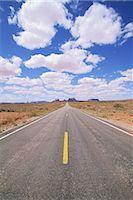 forward - Empty Straight Road against Blue Sky Stock Photo - Premium Royalty-Freenull, Code: 622-02758138