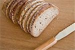 Pieces of Bread on Breadboard with Knife Stock Photo - Premium Royalty-Free, Artist: Westend61, Code: 622-02758570