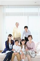 Asian family posing together and looking at camera Stock Photo - Premium Royalty-Freenull, Code: 622-02759150