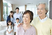 Senior couple standing together with his family in backgroud Stock Photo - Premium Royalty-Freenull, Code: 622-02759165