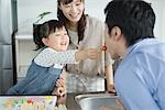Parents with their daughter having breakfast Stock Photo - Premium Royalty-Free, Artist: Aflo Relax               , Code: 622-02759181