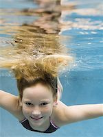 preteen swimsuit - Portrait of a girl swimming underwater Stock Photo - Premium Royalty-Freenull, Code: 640-02764437