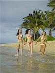 Three teenage girls running on the beach Stock Photo - Premium Royalty-Freenull, Code: 640-02764465