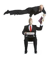 represented - Two male acrobats in business suits performing Stock Photo - Premium Royalty-Freenull, Code: 640-02764550