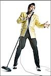 An Elvis impersonator singing into a microphone Stock Photo - Premium Royalty-Free, Artist: Jerzyworks, Code: 640-02764699