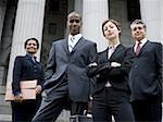 Low angle view of lawyers in front of a courthouse Stock Photo - Premium Royalty-Freenull, Code: 640-02764726