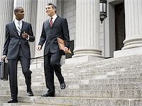 Low angle view of two male lawyers talking on the steps of a courthouse Stock Photo - Premium Royalty-Freenull, Code: 640-02764728
