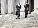 Low angle view of two male lawyers talking on the steps of a courthouse Stock Photo - Premium Royalty-Free, Artist: Robert Harding Images, Code: 640-02764729