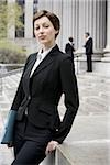 Portrait of a female lawyer smiling Stock Photo - Premium Royalty-Free, Artist: Arcaid, Code: 640-02764732