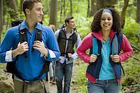 Four young adults hiking in the forest Stock Photo - Premium Royalty-Freenull, Code: 640-02764791