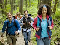 Four young adults hiking in the forest Stock Photo - Premium Royalty-Freenull, Code: 640-02764793
