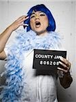 Mug shot of man in dress and feather boa Stock Photo - Premium Royalty-Free, Artist: Robert Harding Images, Code: 640-02764980