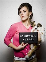 Mug shot of woman with dog Stock Photo - Premium Royalty-Freenull, Code: 640-02765019