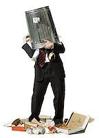 Businessman with trash can on head Stock Photo - Premium Royalty-Freenull, Code: 640-02765028
