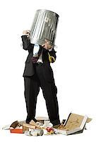 Businessman with trash can on head Stock Photo - Premium Royalty-Freenull, Code: 640-02765029