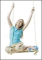 preteen  smile  one  alone - Portrait of a girl swinging on a rope swing Stock Photo - Premium Royalty-Freenull, Code: 640-02765903