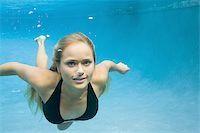 Close-up of a teenage girl swimming underwater Stock Photo - Premium Royalty-Freenull, Code: 640-02765990