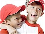 Close-up of two baseball players smiling Stock Photo - Premium Royalty-Free, Artist: Jerzyworks, Code: 640-02766634