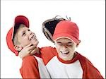 Close-up of two baseball players smiling Stock Photo - Premium Royalty-Free, Artist: F1Online, Code: 640-02766635