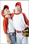 Close-up of two baseball players smiling Stock Photo - Premium Royalty-Free, Artist: F1Online, Code: 640-02766637